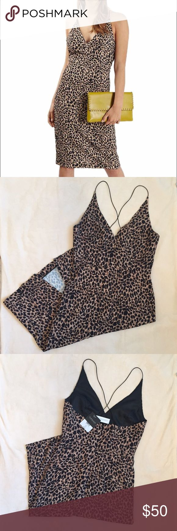 """Bnwt-TOPSHOP Animal Print Body-Con Dress. Size 4 Brand New with Tag TOPSHOP Animal print BodyCon Dress.  *Please see measurement/sizing guide written below for correct fitting.  *This dress appear to be size8 in UK and size 4 in US.  Measurements were taken with clothes laying flat, relaxed and unstretched.  Bust: 16""""  Waist: 13.5""""  Shoulder to Hem(length): 42""""    ▫️Feel free to send me a message with any questions and inquiries. 👍 Topshop Dresses Midi"""