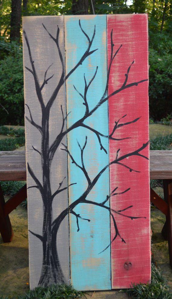Palet madera arte colorido rojo, teal, fondo gris con rama de árbol negro