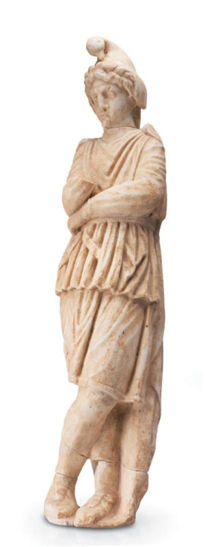 Statue représentant Attis Tristis. Il est vêtu à la mode orientale d'une tunique courte serrée à la taille ainsi que d'un pantalon et de bottes. Il porte un bonnet de type phrygien dont les protèges oreilles tombent sur les épaules. Le bonnet est sommé d'une tête d'oiseau ( iconographie rare). Il est représenté debout, les jambes croisées, dans l'attitude de la méditation. Marbre. Cassée en trois endroits. Un bras manquant. France. IIe-IIIe siècle ap. J.-C.