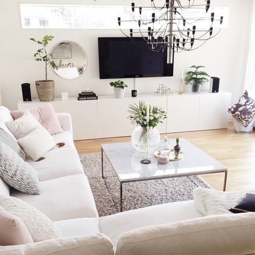 Daily Glamorous living room. White with a hint of pink textiles.