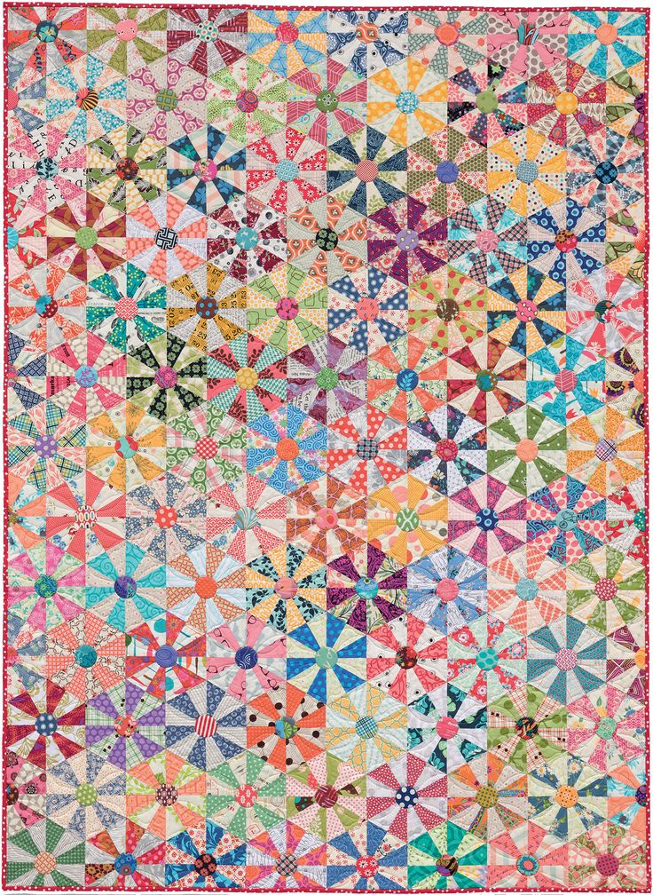 Turn your scraps into wonderful wildflowers! Quilt design by Kim Brackett.