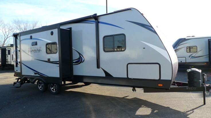 """LIVE HEALTHIER AND HAPPIER IN AN RV!!!  2017 Dutchmen Kodiak Express 253RBSL Eat healthy while you travel by towing along your own personal kitchen in this 29' 1"""" long, 5325 lb. RV! All stainless steel appliances provide the perfect blend of luxury and durability, and a stunning skylight lets warm, natural sunshine fill the room as you chop up fresh fruits and veggies! Give our Kodiak Express expert Norman Wells a call 231-730-3481 for pricing and more information."""