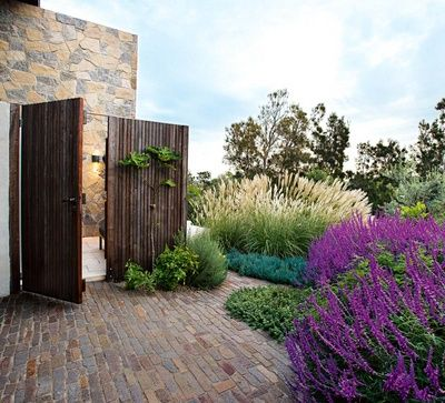 wood gate entry, native plants, scale