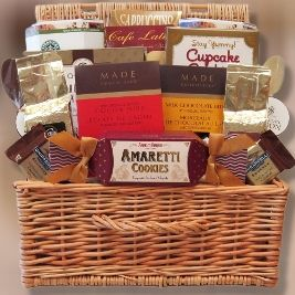 Cafe Bistro - Our keepsake wicker hamper offers Almond Amaretto gourmet flavored coffee, Irish Cream gourmet flavored coffee, Starbucks Caffe Verona coffee, Starbucks Veranda Blend coffee, rich cappuccino drink mix, café latte barista blend coffee, chocolate stirring spoons (2), Ghirardelli caramel squares (2), dark chocolate cocoa nibs, milk chocolate bites with ground espresso, cupcake shaped triple chocolate cookies, double chocolate french cookies and Italian amaretti cookies.