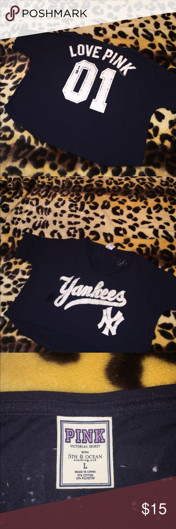Victoria's Secret pink Yankees baseball half shirt Victoria's Secret pink navy blue with white glittered lettering New York Yankees baseball half shirt. This is a belly shirt. Size large.  I am open to reasonable offers. 15% bundle discount on 3 or more items. Smoke free home. Happy poshing! 😊 PINK Victoria's Secret Tops Tees - Short Sleeve