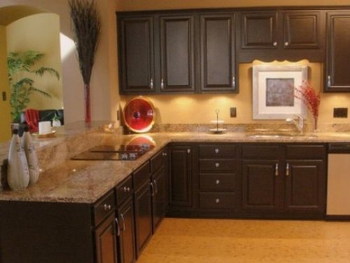 Kitchen with tan brown granite countertops for the home for Brown kitchen cabinets with black granite