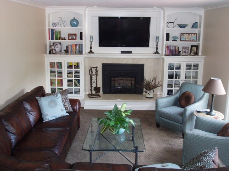 Long narrow living room with fireplace on end wall for Tv room arrangements