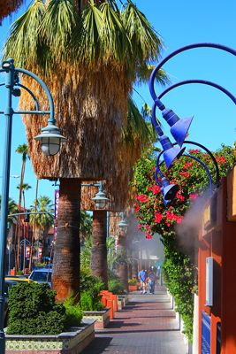 Blue skies, green palm trees and misters for the hot summer sunshine in downtown palm springs!