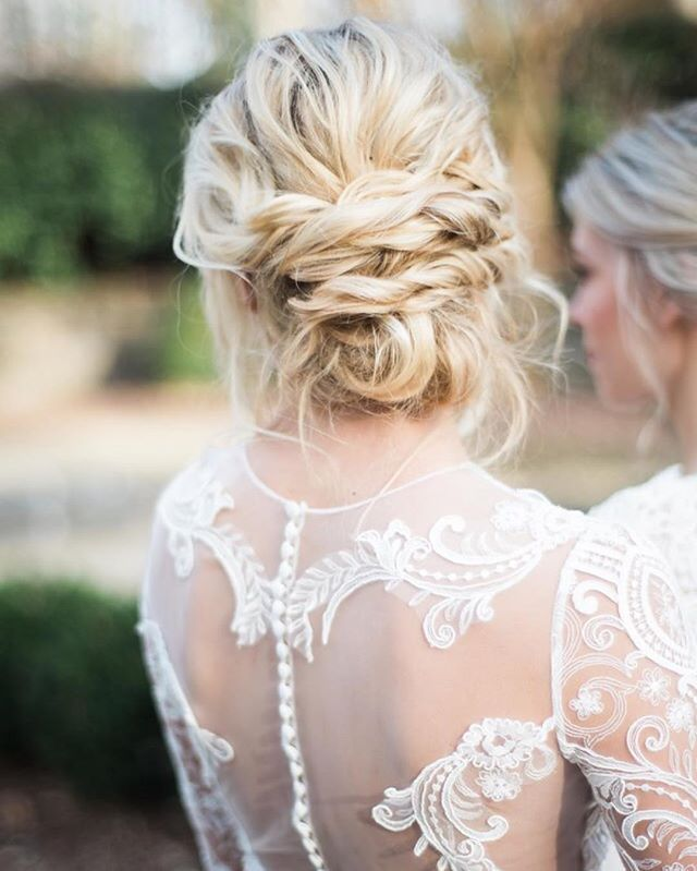 Bridal goals : sheer lace & loose low braided bun for a stunning effortless and chic look • photo @kannephoto dress: Endora from our collection 017