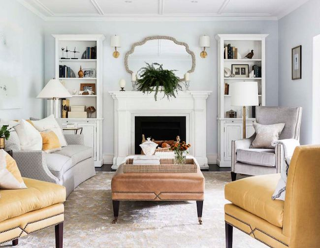 Yellow and gray living room features a curved gray sofa adorned with yellow  pillows alongside a pair of yellow accent chairs with brass tacks from  Kravet. 1181 best Living Rooms images on Pinterest   Architecture  Arrange