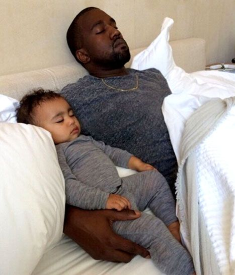 North and Kanye West snooze together on the eve of her first birthday, and Father's Day. So cute