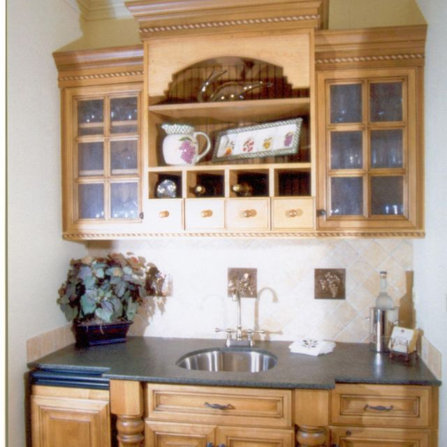 small wet bar i like the color of the cabinets