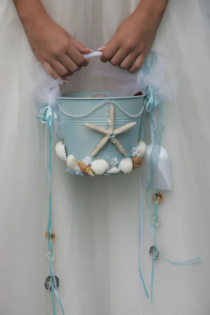 for sam                                                        Cuuute idea for bri: Beach Wedding Flower Girl Starfish Beach Pail by artseero on Etsy. But Definitely looks easy enough for a DIY! @Fabiola Campos what do you think of this?