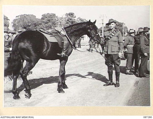 The lone charger - Sir Harry Chauvel's horse with the ride boots set in reverse, at his funeral in 1945. Australian War Memorial 087280. Click through to piece explaining the significance of the riderless horse.
