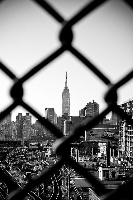 The Empire State Building from the Pulaski Bridge in Queens. #city #blackandwhite