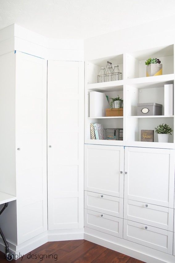 Building in Cabinets - IKEA Hack Craft Room IKEA cabinet built-in PAX units are on a 2x4 base and BESTA units are on a double height 2x4 base for each one