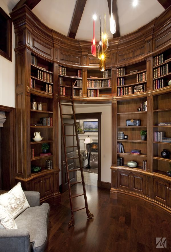 Love the idea of a round, two floor library, with both offices hidden behind the shelves