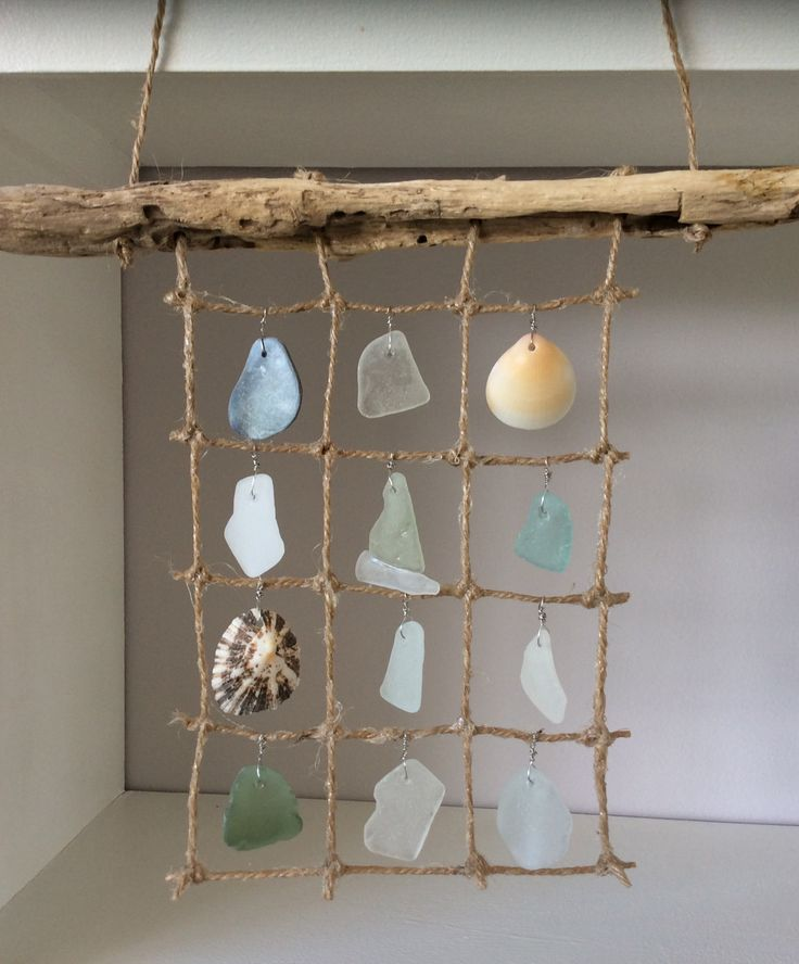 Mermaid curtains, with sea glass, driftwood and shells.