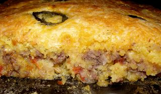 2 boxes jiffy cornbread mix 1 can cream style corn 2 chopped jalapenos 6 oz Mexican cheese or more 1 1/2 hamburger small onion chop...