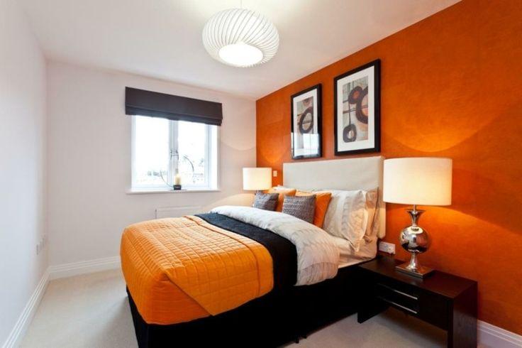 dormitorio pequeño en blanco y naranja