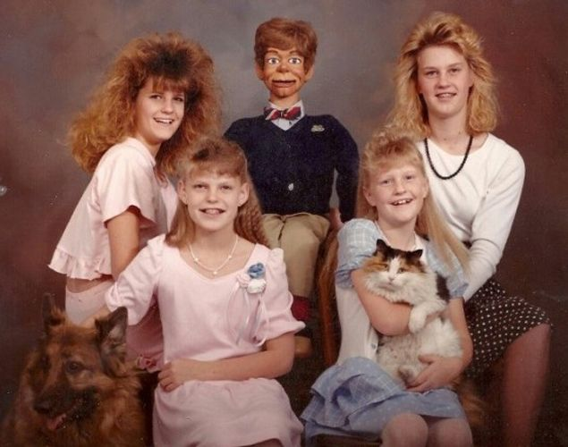 awkward photos -- I don't know what's more terrifying, the dummy or the girl in the upper left corner's hair...