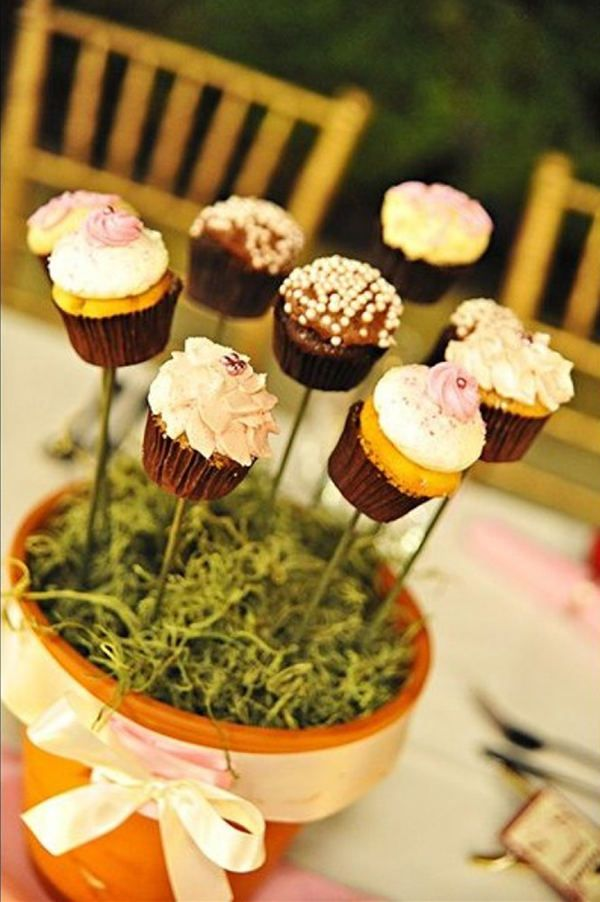 Cupcake Centrepiece - For Modern Brides: 25 Fabulous Wedding Centerpieces Without Flowers - EverAfterGuide