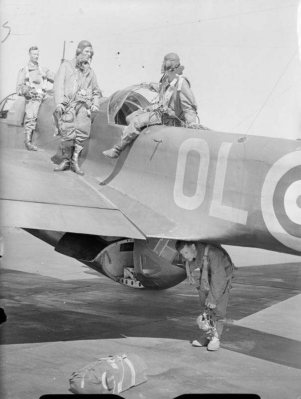 The crew of a Handley Page Hampden Mark I of No. 83 Squadron RAF leave their aircraft at Scampton, Lincolnshire, on returning from a flight.