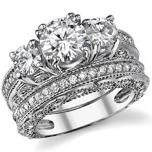 I would rather have a giant flashy ring that i will wear forever then a giant flashy dress that i will wear one day :) this is where the money will go