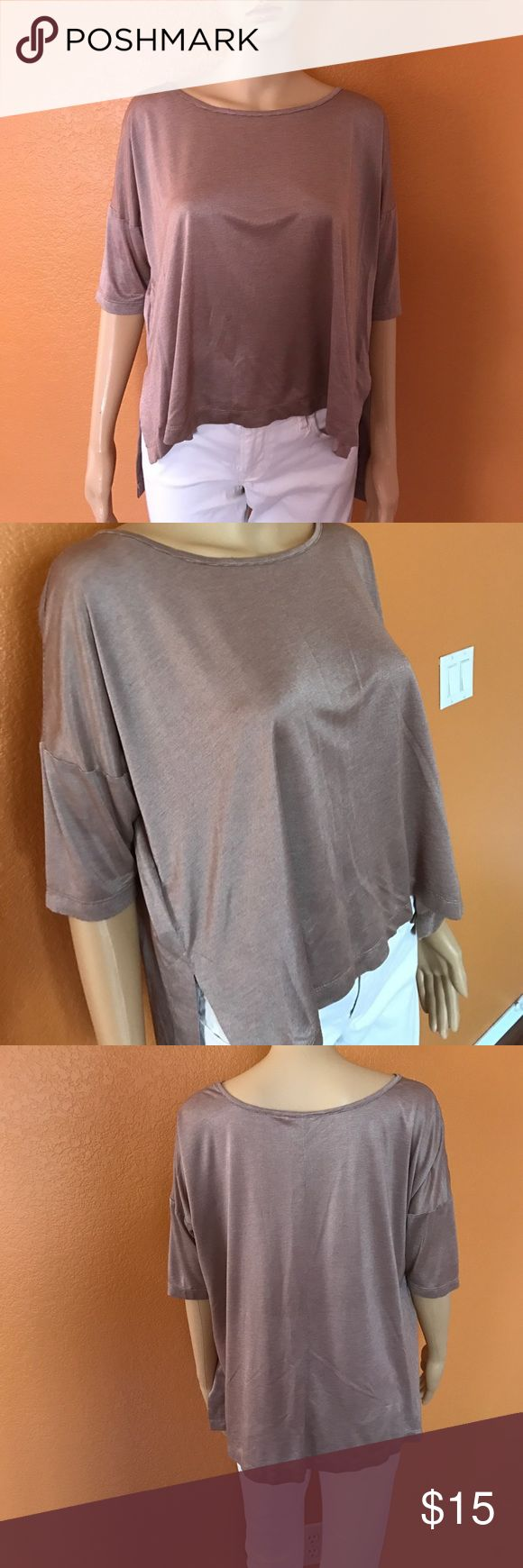 Bcbgeneration Top Cappuccino color, small size top looks silky it's really comfy and it's high low. BCBGeneration Tops Tees - Short Sleeve