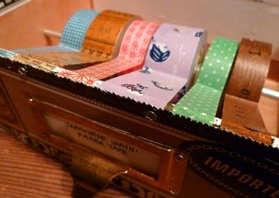 This is a tutorial on how to convert a cigar box into a holder for Japanese Washi tape or you could even use for a variety of other tapes.  I use painters tape in various sizes and types, so I am (someday) going to make this for my craft room but will have to use a different size box.  The concept is pretty cool.
