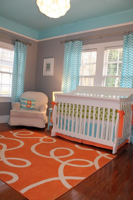 Aqua & Orange Nursery. Love the crib skirt.