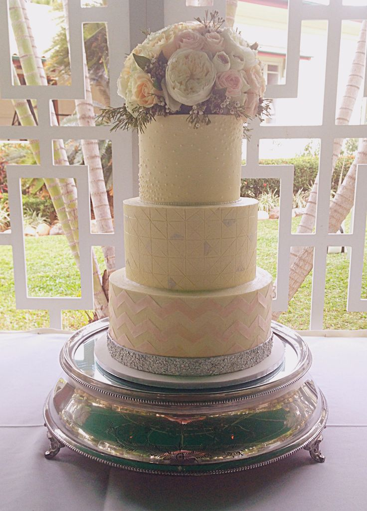 Buttercream finish with patterned details to match the invitations. Fresh flowers by Anitra from Flourish Floristry.