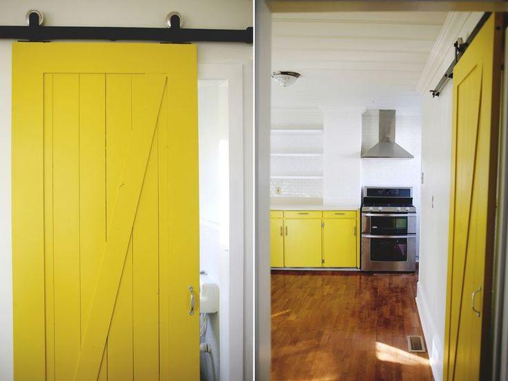 Yellow barn door for bathroom pocket door