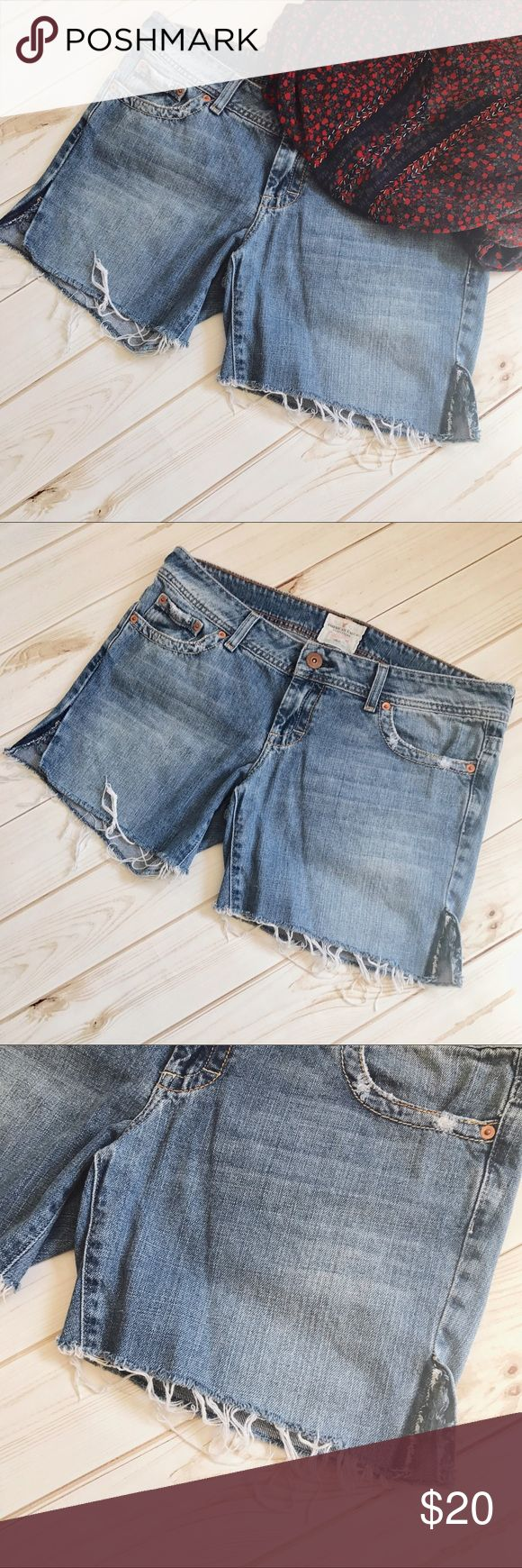 """American Eagle Distressed Jean Shorts Comfy, distressed American Eagle Outfitters five-pocket, cutoff jean shorts. Features distressed bottoms, side slits & distressing on pockets. AOE targets juniors, so most likely these fit like Juniors sizing, but please refer to measurements to be sure. Flat measurements: inseam 6""""; rise 3""""; waist 18.5""""; hips 20.5"""". Preloved and in good condition. NO TRADES. Please ask questions or request additional photos prior to purchasing. American Eagle Outfitters…"""