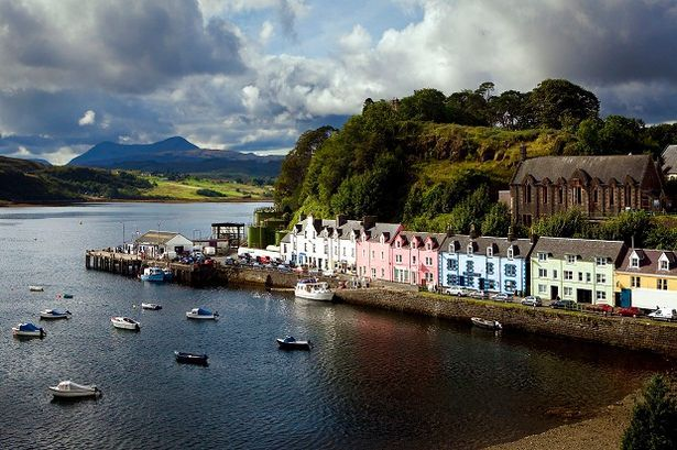 The fishing boat harbor at Portree, Isle of Skye  The Isle of Skye is an incomparably beautiful island located off the west coast of Scotland. You can visit the colorful town of Portree, eat fish and chips, drink delicious whisky and explore Dunvegan castle.
