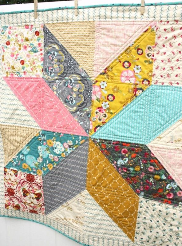 """One Lone Star block blown-up big size makes a bright and beautiful baby quilt. Designed by Quilt Blogger Amy Smart, this easy to tackle quilt project can be assembled with pre-cut 10"""" x 10"""" fabric squares."""