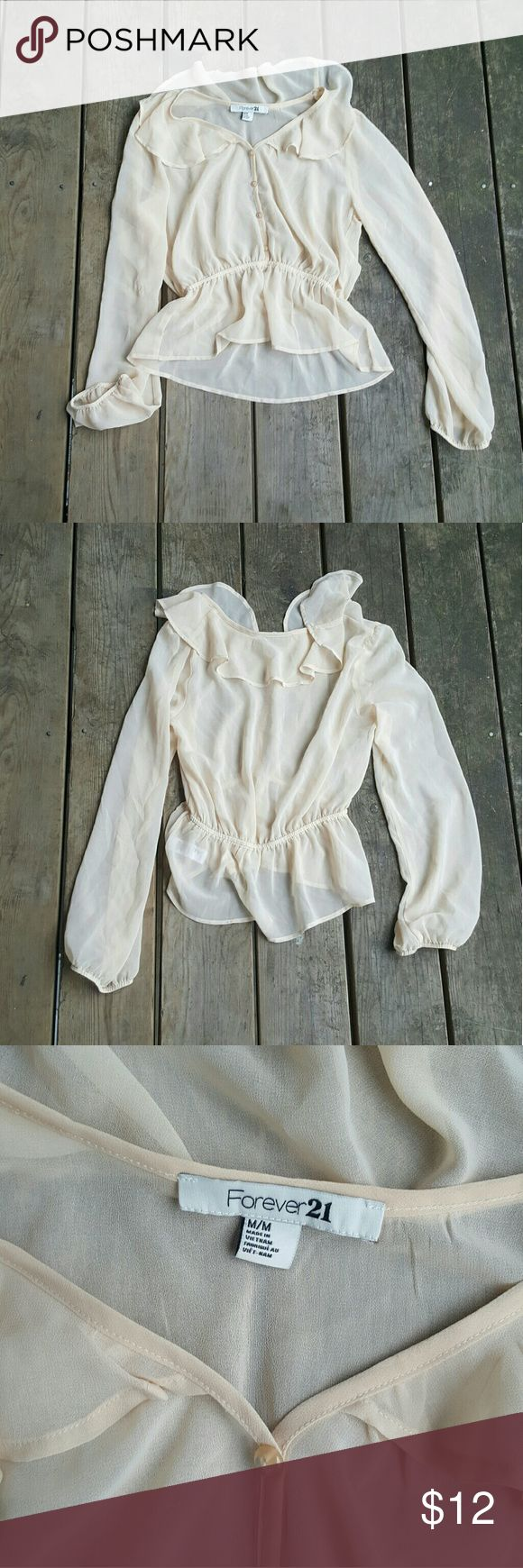 Cream peplum top Cream sheer peplum top with long sleeves. Buttons in front, elastic cuffs. No major flaws, great condition!! Brand is Forever 21, size M, medium.  Every purchase comes with a makeup gift! Forever 21 Tops Blouses