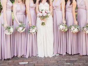 Your junior bridesmaid -- too old to be a flower girl, too young to be a bridesmaid -- requires special consideration. Here are answers to some common etiquette questions on what she wears, who can escort her, how to gift her, and more.