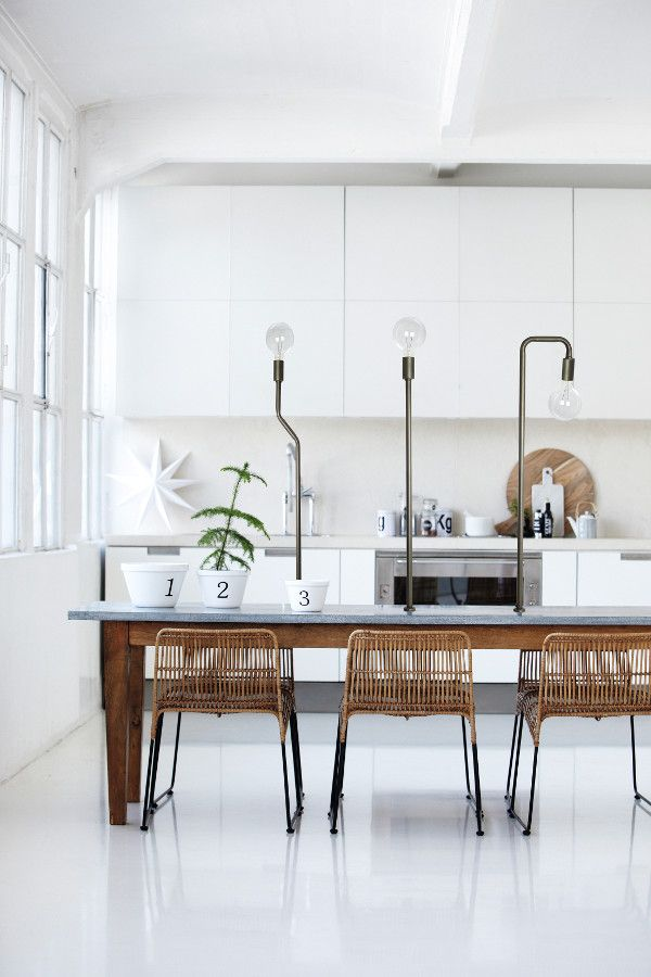 White kitchen with timber accents.