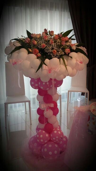 Balloons and flowers column centerpiece wedding mother