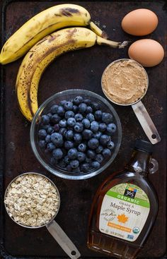 Flourless Blueberry Banana Muffins are a wholesome treat to enjoy for breakfast or a snack. They're made easy in a blender and are gluten-free, oil-free, dairy-free and refined sugar-free! #cleaneating