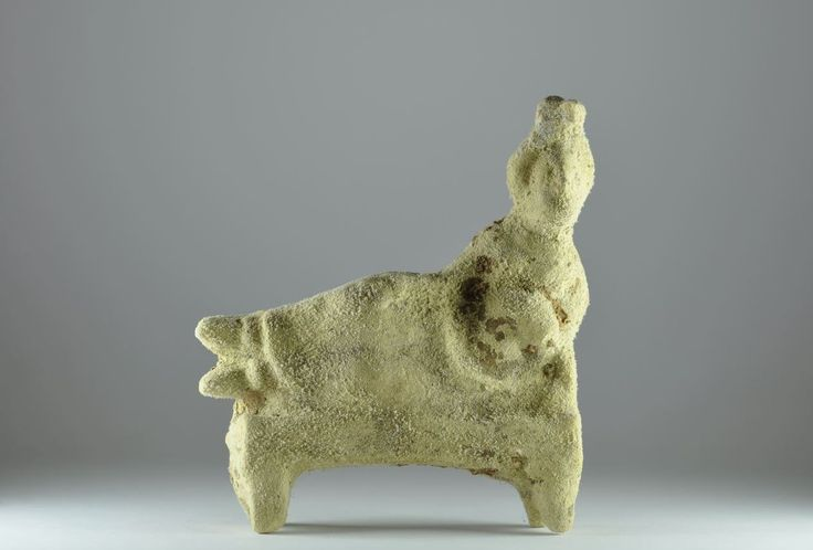 Parthian pottery female banqueter, 2nd-3rd century A.D. Female banqueter reclining on a low bed, 13.8 cm high. Private collection
