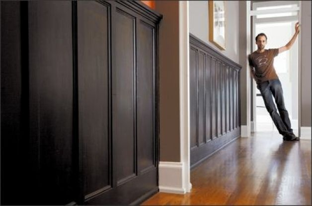 Possibly black wainscotting?? Architect Jean-Francois Godbout, above, put a coat of paint on some wainscoting he bought at Earthwise and installed it in his hallway, dining room and an upstairs wall.