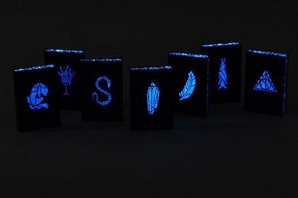"Nagy said the effect was created using a white spray paint that contained phosphorescent grains ""so it glows in the dark with strong blue color."" 