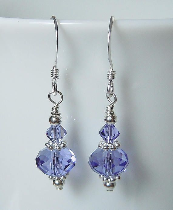 Stunning Swarovski Tanzanite (like a periwinkle blue-purple color) crystals and sparkling silver contrasting accents handcrafted on sterling silver French ear wires. These beautiful earrings shimmer like only Swarovski can! Finished length is about 1. Please convo us with any