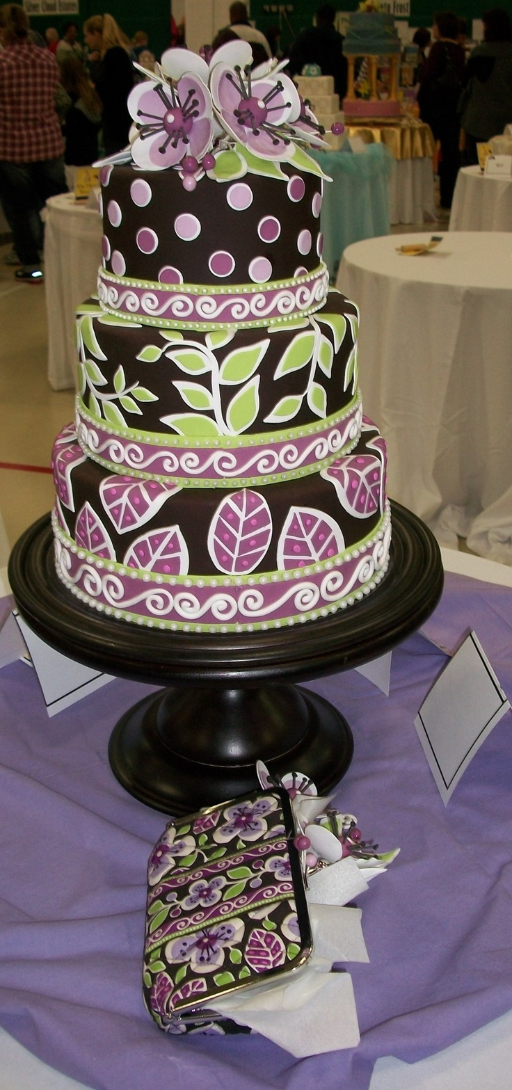 This is another awesome vera bradley cake!!  Here is one that was inspired by the color plum petals. There's a wristlet in the actual color beside it on the table, and you can see that whomever made this did a really good job!!  I'm thinking about doing this maybe for my birthday!