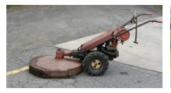 Gravely tractor mid 1960's walk-behind.  Cultivator, plow, snowblower, brush hog,  mower, water pumper, and more.