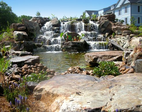 This cascading stone waterfall provides a stunning entrance for a Lake Marion residential development.  Santee, SC
