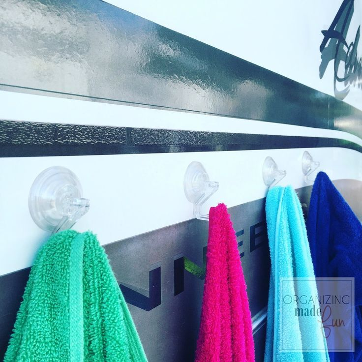 Use suction cup hooks to hang towels on the side of the RV :: http://OrganzingMadeFun.com
