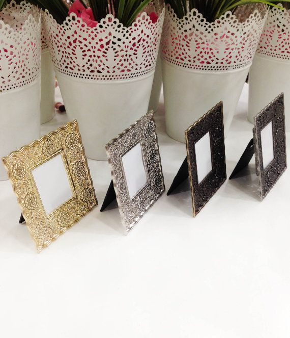 Great idea for elegant weddings, engagement, baby shower theme events and other specific ceremonies. Are you looking for unique table name holder or table name holders, will be amazing choice. Our Zamac frames perfect for any occasion from wedding to baby showers.  Preparing from hard metals ( Aluminium, Magnesium, Zinc and Copper. - ZAMAK ) For about more information ZAMAK; http://en.wikipedia.org/wiki/Zamak  Name or number printing service is FREE!  Outer size of the frame: ↔ Width: 9,3…